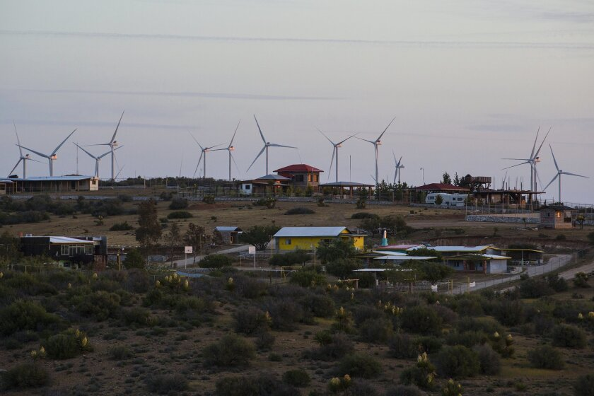 At sunrise and off in the distance from the town of La Rumorosa in Mexico are Sempra Energy s field of 47 wind turbines that produce 155 megawatts of electricity enough to to power as many 100,000 homes at a time.  Or at full tilt, each turbine is capable of generating 3.3 megawatts of electricity