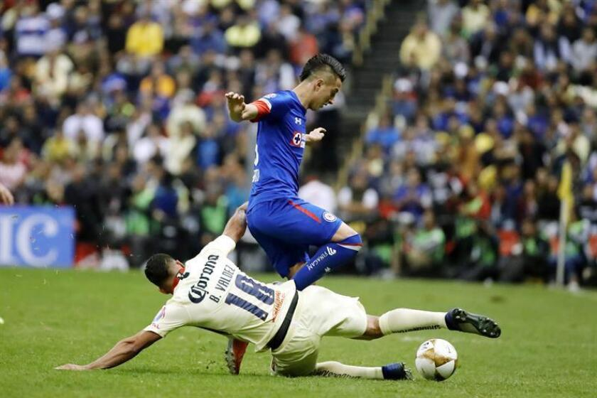 Club America's Bruno Valdez (bottom) vies for the ball with Cruz Azul's Roberto Alvarado during the first leg of the Mexican soccer league's Apertura 2018 final, a match played at Estadio Azteca in Mexico City, Mexico, on Dec. 13, 2018. EPA-EFE/JOSE MENDEZ
