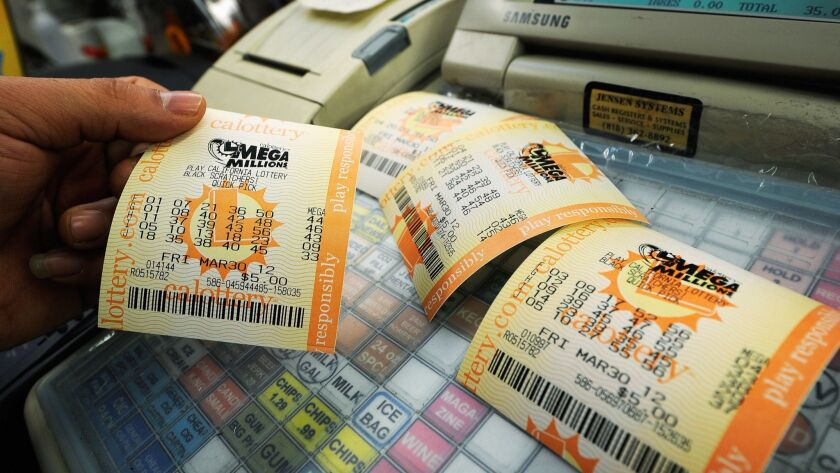 Mega Millions lottery tickets sit on a cash register in Covina in 2013.