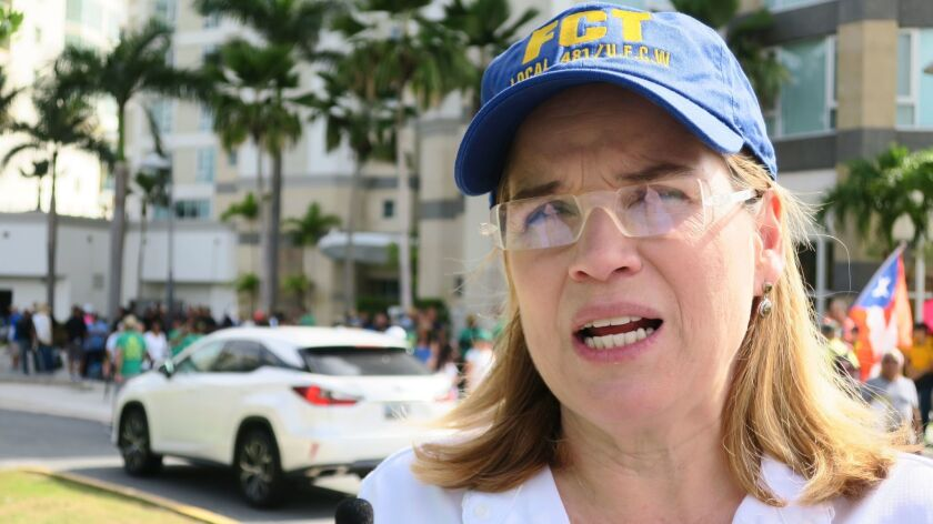 Carmen Yulin Cruz, the mayor of San Juan, Puerto Rico's capital, speaks to the media before Tuesday's marches.
