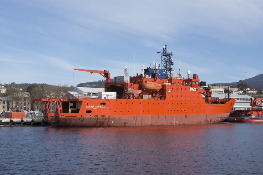 This Aug. 20, 2016, photo shows Australian icebreaker the Aurora Australis docked at Franklin Wharf in Hobart, Australia. The giant orange icebreaker Aurora Australis left Australia for the final time on Saturday, Dec. 12, 2020, after more than 150 trips to Antarctica. Next stop: a shipyard in Dubai, where it will be refurbished and either leased or sold. (Sarah Motherwell/AAP Image via AP)