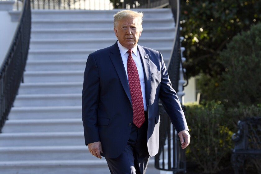 President Donald Trump walks over to talk with reporters on the South Lawn of the White House in Washington, Sunday, Sept. 22, 2019, as he prepares to board Marine One for the short trip to Andrews Air Force Base. Trump is traveling to Texas and Ohio before heading to New York for the upcoming United Nations General assembly. (AP Photo/Susan Walsh)