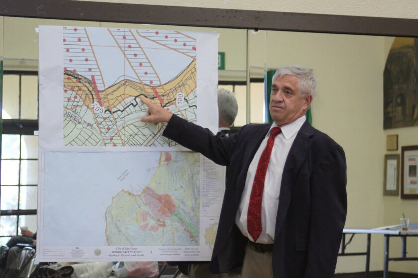 Michael Pallomary with a geographic map of the area showing how 'live loading' it with cars might pose a problem.