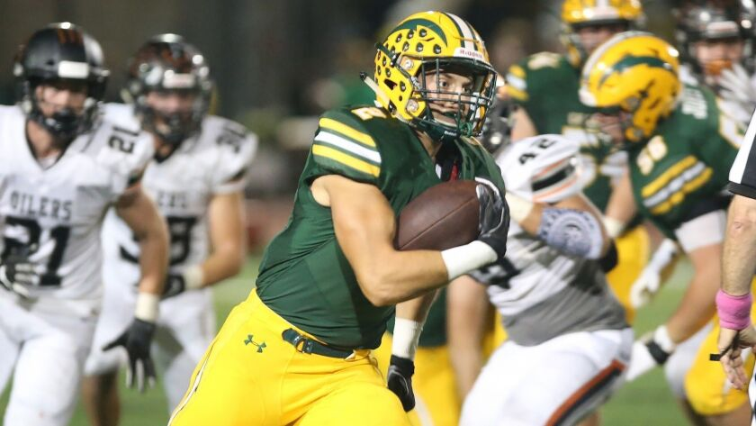 Edison's Mike Walters runs into the open space for a touchdown during Sunset League football agains