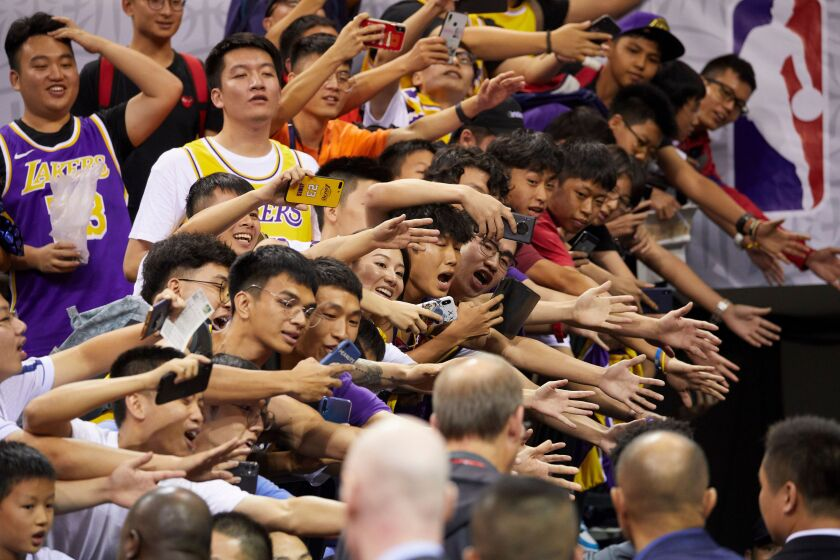 Fans reach out to players after an NBA preseason game between the Lakers and Brooklyn Nets in China on Oct. 12.