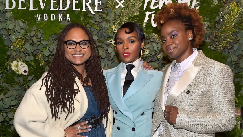 Ava DuVernay, left, Janelle Monáe and Dee Rees attend the Fem the Future brunch in L.A.