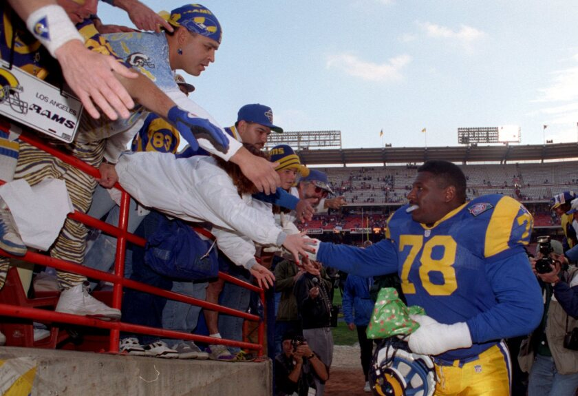 Jackie Slater shakes hands with Rams fans in 1994.