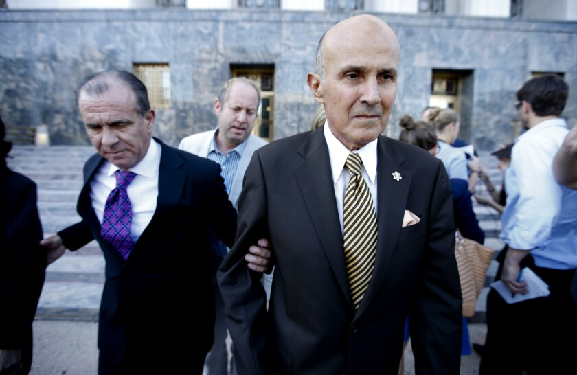 Former Los Angeles County Sheriff Lee Baca leaves a downtown courthouse in February after pleading guilty to lying to federal investigators.