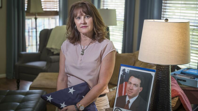 Tresa Roth, whose husband, FBI Agent Robert Roth, died from cancer in 2008, with memorabilia from his time at the agency. He assisted rescue and investigative efforts at the Pentagon after the Sept. 11 attacks in 2001.