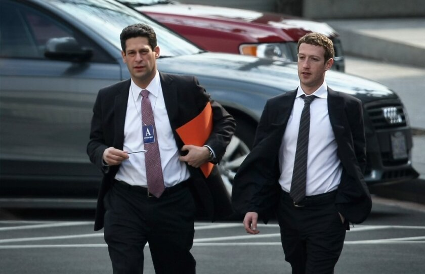 Facebook CEO Mark Zuckerberg, right, arrives at the White House for a meeting with President Obama over NSA spying.