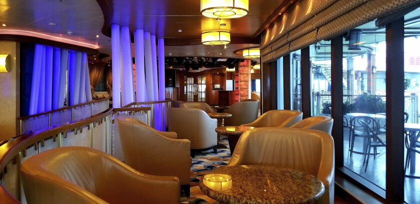This photo provided by Michele Smith, shows an empty dining center on the Grand Princess cruise ship Friday, March 6, 2020, off the California coast. Scrambling to keep the coronavirus at bay, officials ordered a cruise ship with about 3,500 people aboard to stay back from the California coast until passengers and crew can be tested, after a traveler from its previous voyage died of the disease and at least two others became infected. A Coast Guard helicopter lowered test kits onto the 951-foot (290-meter) Grand Princess by rope as the vessel lay at anchor off Northern California, and authorities said the results would be available on Friday, March 6, 2020. Princess Cruise Lines said fewer than 100 people aboard had been identified for testing. (Michele Smith via AP)