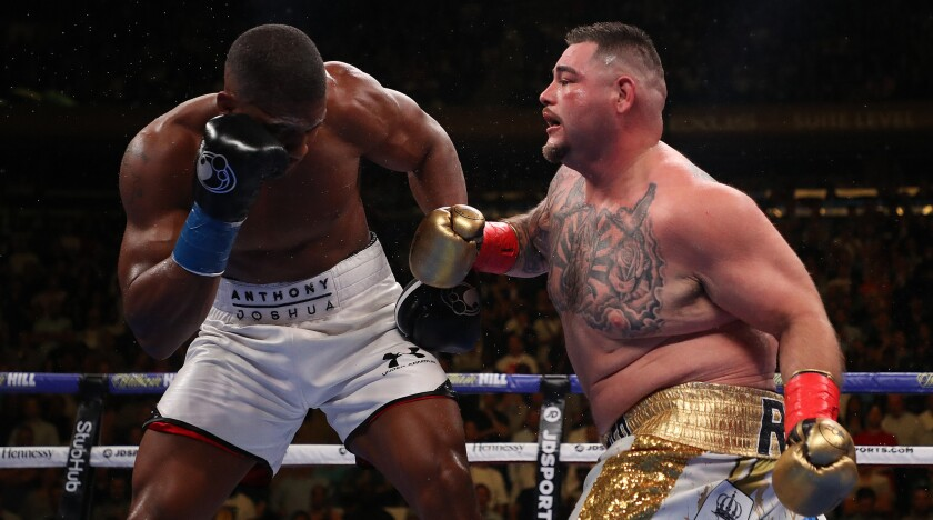 Andy Ruiz, right, punches Anthony Joshua during their heavyweight title fight.