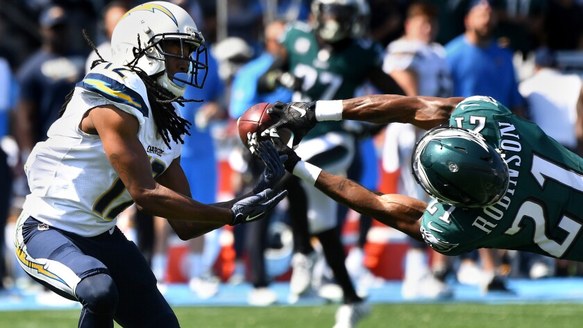 Eagles cornerback Patrick Robinson breaks up a pass intended for Chargers receiver Travis Benjamin during the first quarter.