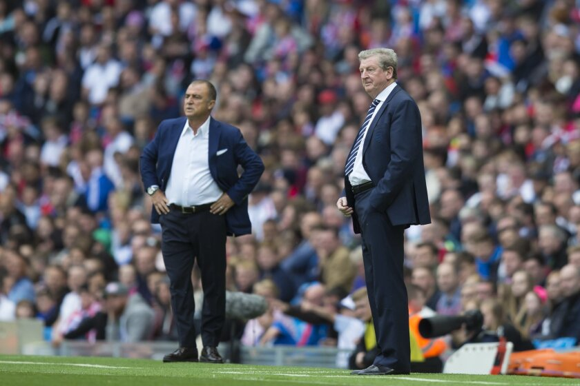 FILE - In this Sunday May 22, 2016 file photo, England's manager Roy Hodgson, right, and Turkey's manager Fatih Terim watch the international friendly soccer match at the City of Manchester Stadium, Manchester, England. (AP Photo/Jon Super, File)