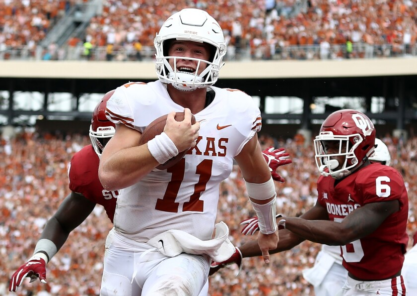 Texas quarterback Sam Ehlinger scores a touchdown against the Oklahoma Sooners in October 2018.