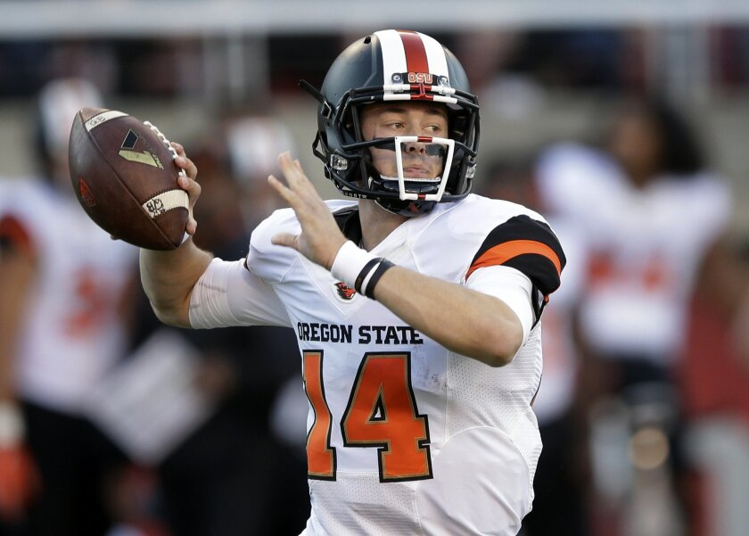 FILE - In this Oct. 31, 2015, file photo, Oregon State quarterback Nick Mitchell prepares to pass the ball against Utah in the first quarter during an NCAA college football game, in Salt Lake City. Mitchell's first tests at starting quarterback for Oregon State have been challenging, to say the lea