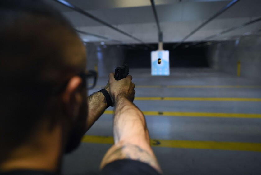 One obstacle to gun owners' acceptance of safety technology is its identification with anti-gun activism. Above, a man fires a handgun at a shooting range in New Jersey.