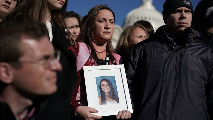 Lori Alhadeff holds a picture of her daughter, Alyssa, during a news conference on gun control on March 23 in Washington.
