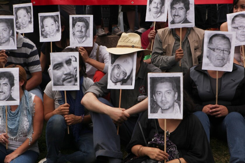 In Mexico City, journalists protest the slaying of their colleague Gregorio Jimenez and others.