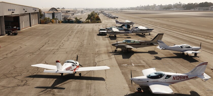 Small private aircraft line the runway at Santa Monica Municipal Airport, which is locked in a legal battle over its future. Two aviation companies recently received eviction notices.