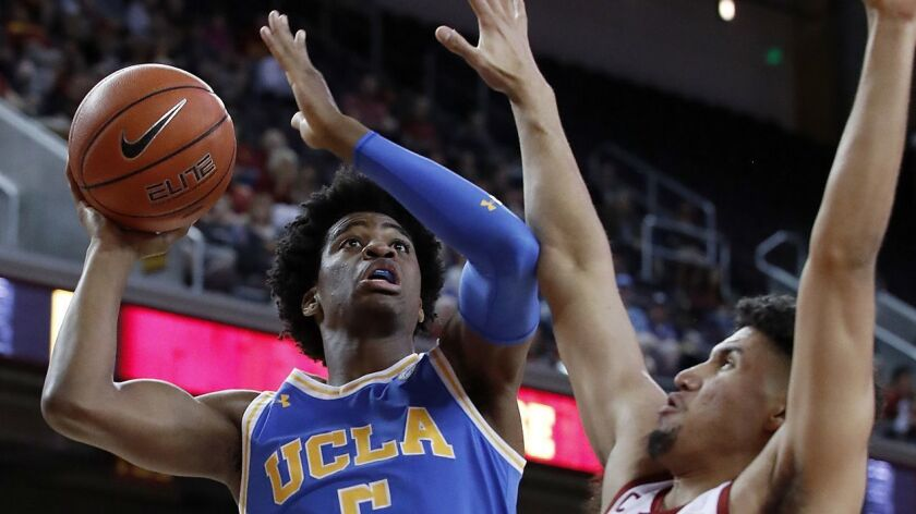 UCLA guard Chris Smith drives to the basket during a game against USC in January.