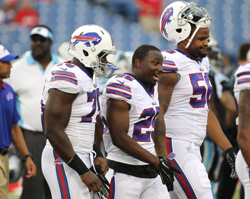FILE - In this Friday, Aug. 14, 2015, file photo, Buffalo Bills linebacker Ikemefuna Enemkpali, left, running back LeSean McCoy (25) and Cedric Reed (56) walk on the field before an NFL preseason football game against the Carolina Panthers in Orchard Park, N.Y. McCoy was escorted off the field after hurting his upper left leg during practice with the Cleveland Browns on Tuesday, Aug. 18. (AP Photo/Bill Wippert, File)