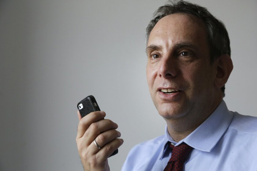 StoryCorps founder Dave Isay demonstrates how to record a story using a smartphone app Wednesday, March 25, 2015, in the Brooklyn borough of New York. Isay recently won the 2015 TED Prize of $1 million to help carry out his wish for a worldwide expansion of the StoryCorps project. After amassing a