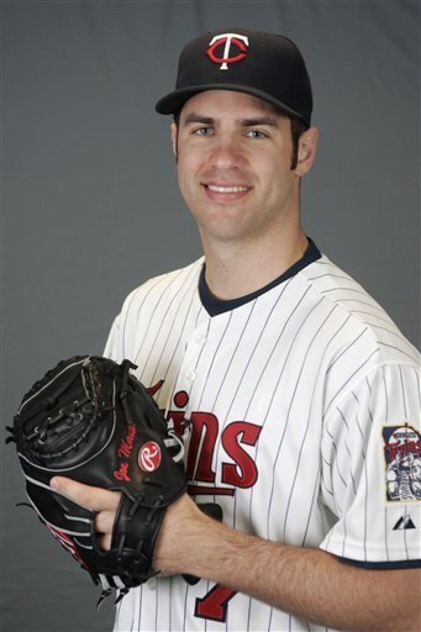 FILE - This is a 2009 file photo showing Minnesota Twins baseball player Joe Mauer. Mauer has become only the second catcher in 33 years to win the American League Most Valuable Player Award, Monday, Nov. 23, 2009.  (AP Photo/Steve Senne, File)