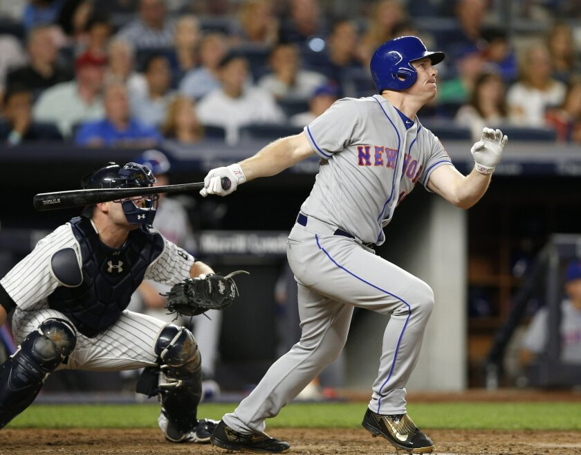 New York Mets' Jay Bruce watches his fifth-inning, three-run home run off New York Yankees starting pitcher Nathan Eovaldi during a baseball game Thursday, Aug. 4, 2016, in New York. (AP Photo/Kathy Willens)