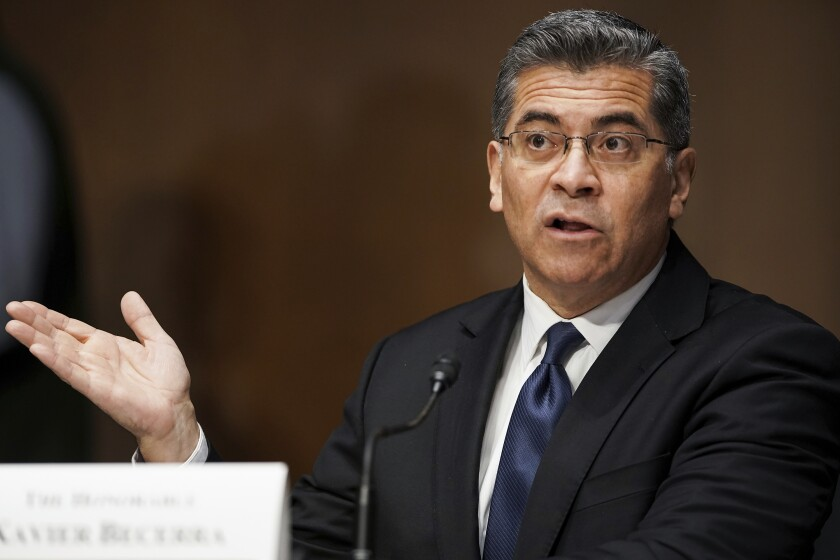 California Atty. Gen. Xavier Becerra testifies at a Senate committee hearing