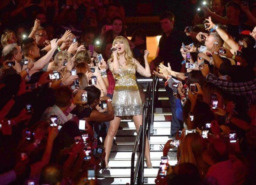 Taylor Swift performs at the iHeartRadio Music Festival at the MGM Grand Garden Arena in Las Vegas.