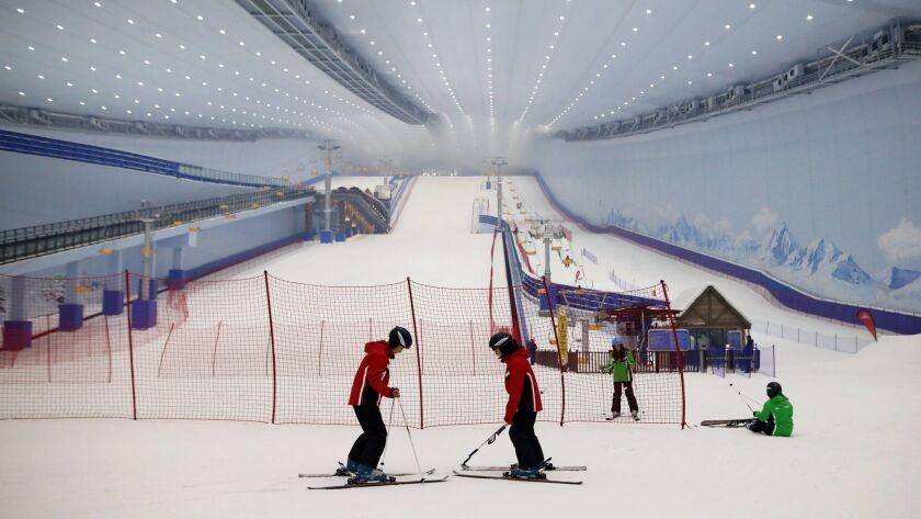 People ski at Harbin Wanda City's indoor ski resort during the opening of the Wanda Cultural Tourism