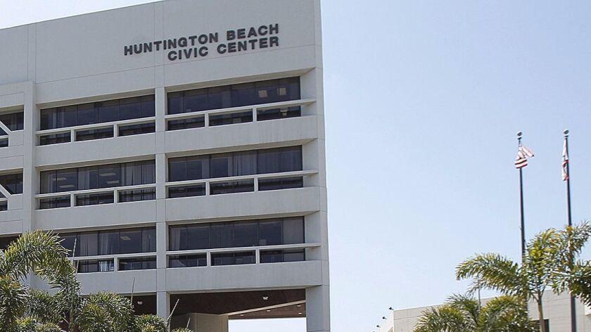 Members of the Huntington Beach hazardous materials team don hazmat suits before collecting a sample