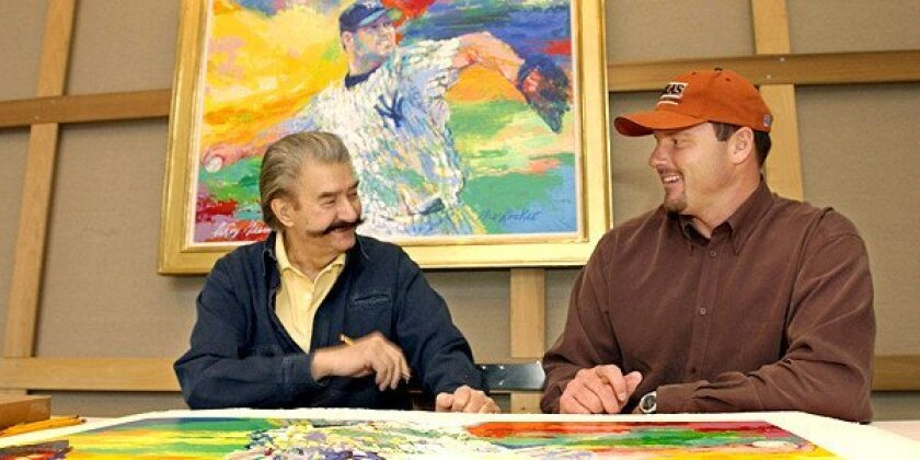 """On Nov. 13, 2003, New York Yankees pitcher Roger Clemens, right, talks to artist Leroy Neiman about baseball while signing limited-edition serigraphs based on Neiman's painting """"The Rocket,"""" above, of Clemens on the mound in pinstripes, at Neiman's New York studio."""