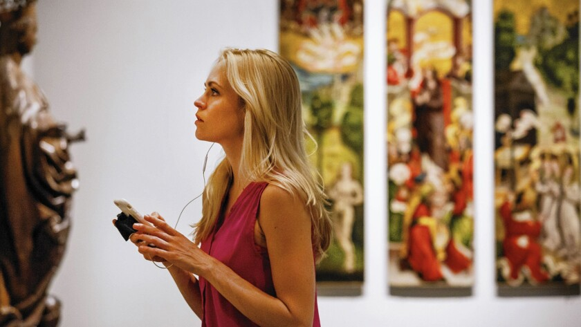 A LACMA visitor uses the museum's mobile app