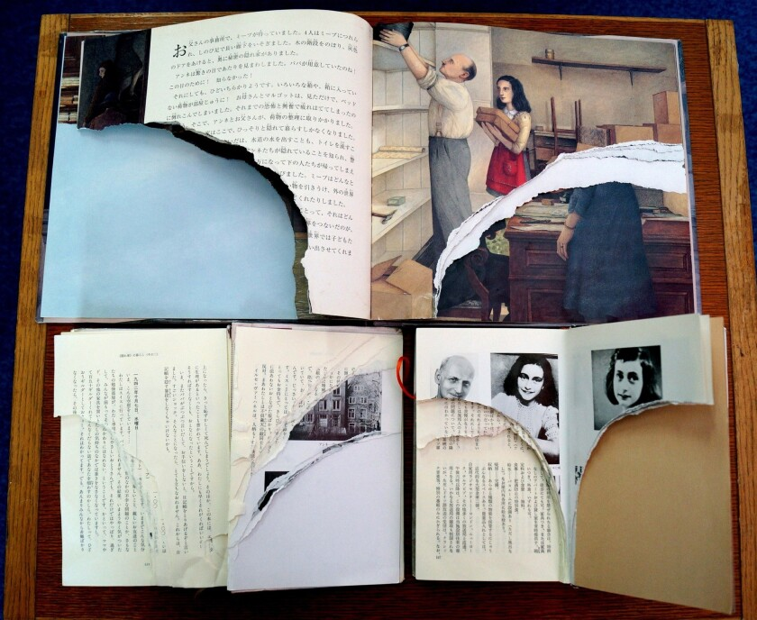 "Three copies of Anne Frank's ""The Diary of a Young Girl"" with pages ripped out at a library in Tokyo."