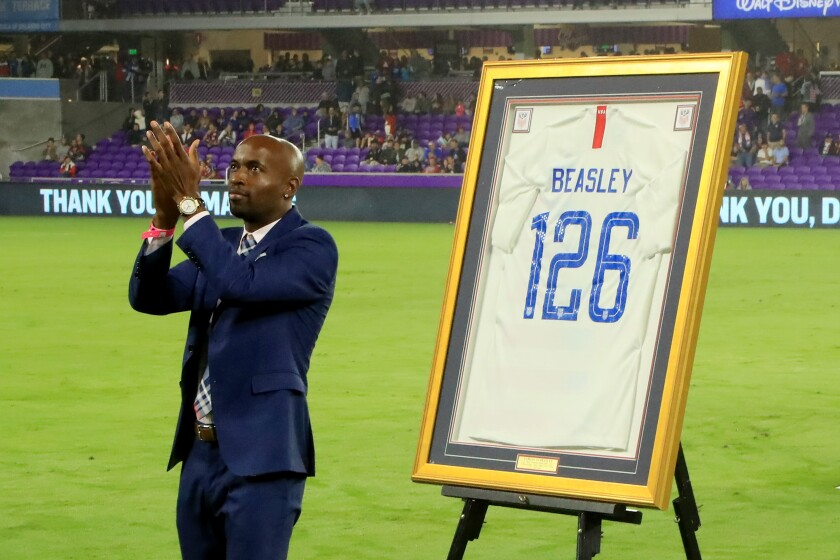 """DaMarcus Beasley is honored before a match between the United States and Canada on Nov. 15 in Orlando, Fla. In his career, he has been the target of racial slurs in European stadiums.  """"It's so hard to act like you don't hear it,"""" he says."""