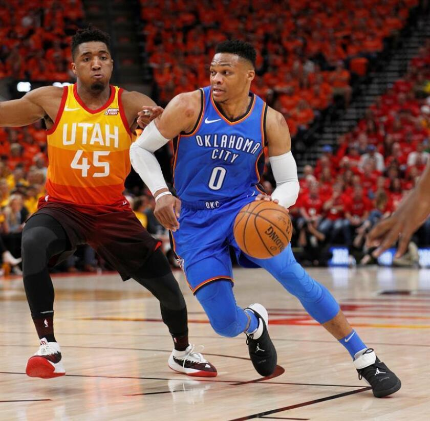 Oklahoma City Thunder guard Russell Westbrook (C) drives to the basket past Utah Jazz guard Donovan Mitchell (L) in the first half during the NBA Western Conference First Round playoff game three at Vivint Smart Home Arena in Salt Lake City, Utah, USA. EFE