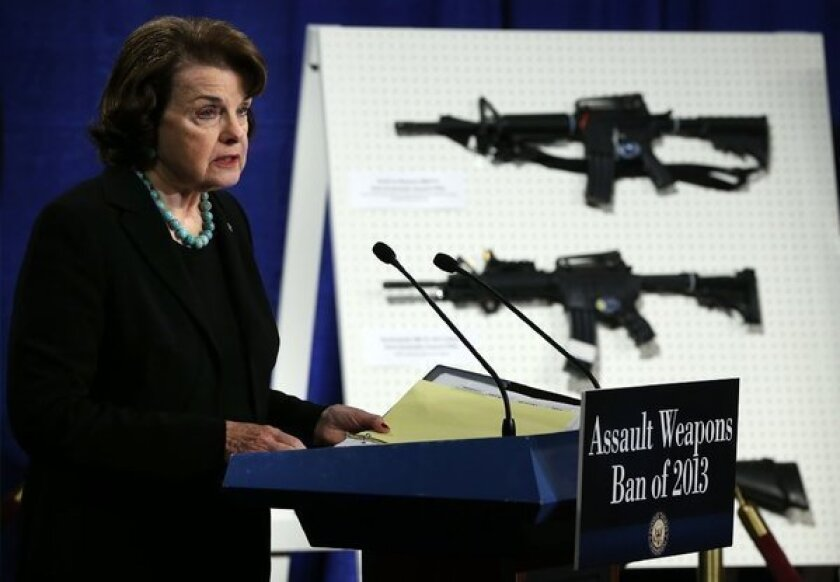 Sen. Dianne Feinstein speaks next to a display on assault weapons during a news conference in 2013. Feinstein introduced legislation Wednesday to ban the sale and possession of military-style assault weapons.