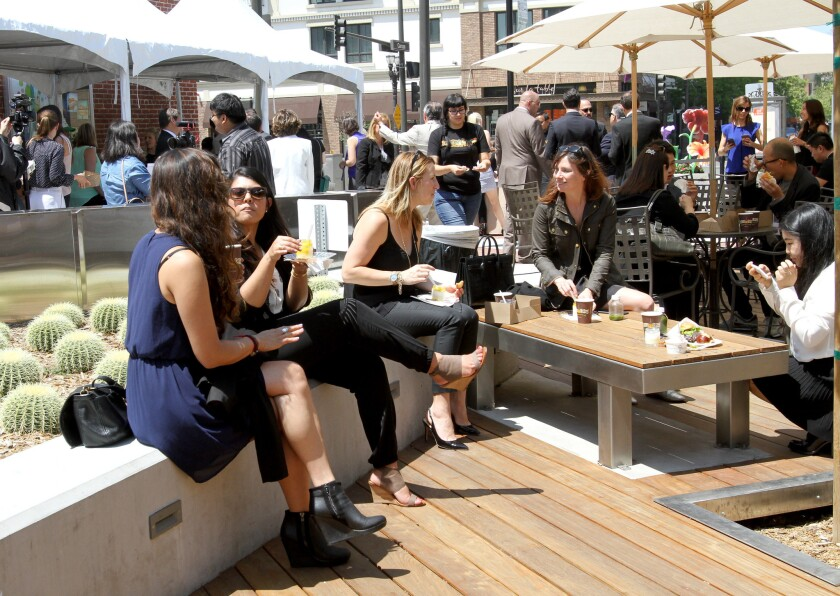 Attendees enjoy food at event