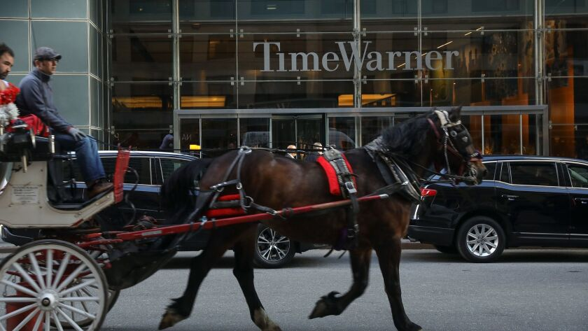 AT&T on Thursday closed its $85-billion purchase of Time Warner, above, based in New York.
