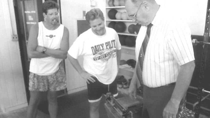 Barry Faulkner, left, is seen here during a weigh-in to lose weight as a fundraiser for the Newport