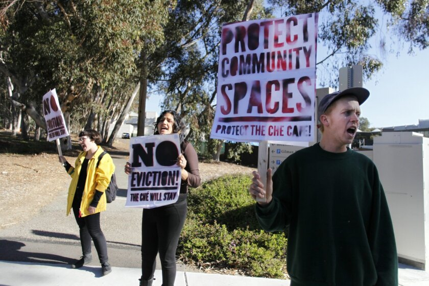 Palomar College student Lore, who would not give her last name, Grossmont College student Lidia Marin and Matt Swanguen of San Diego protest the looming eviction of the Ché Café at UC San Diego on Tuesday.