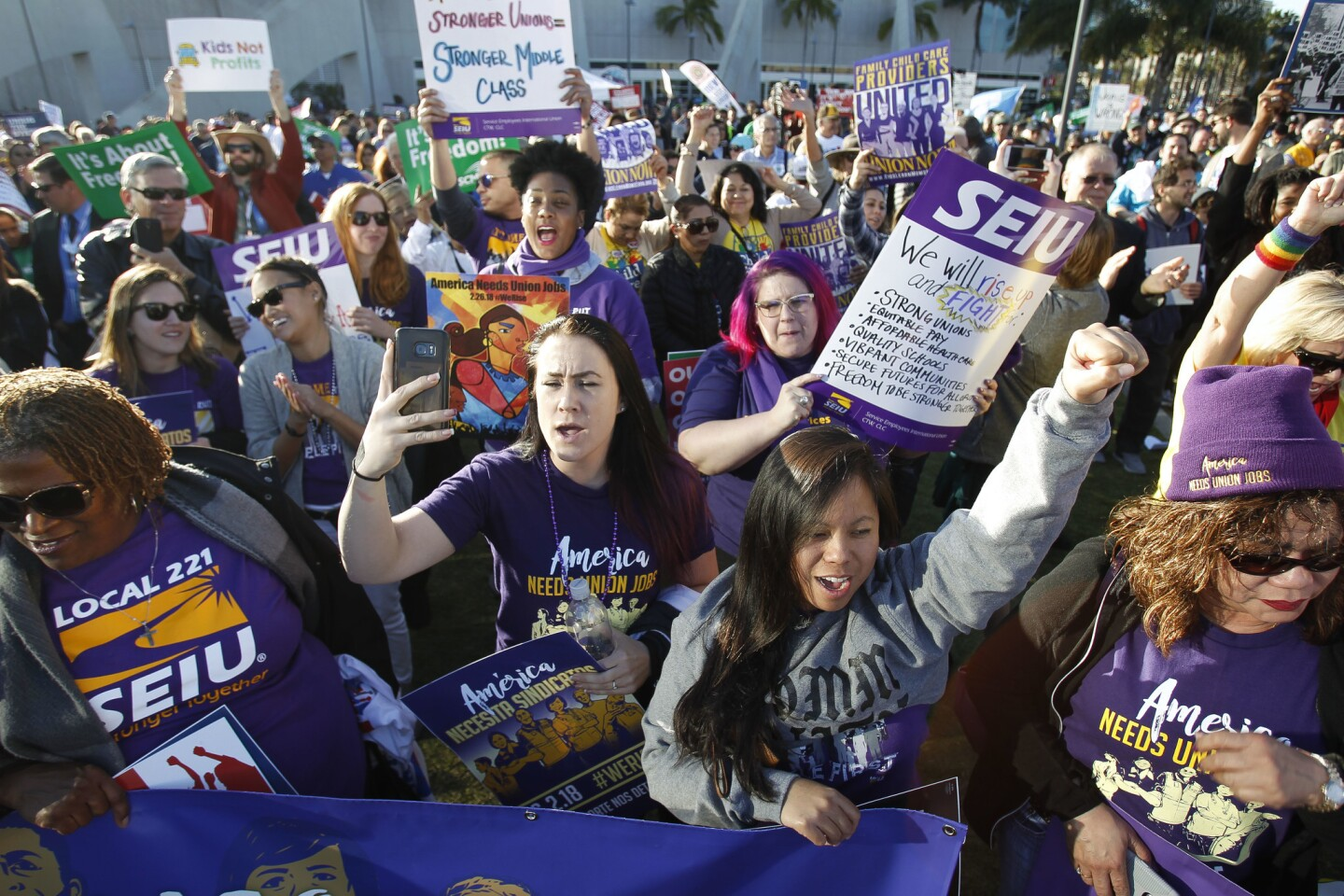 Union members cheer as they listen to billionaire hedge fund manager and progressive activist Tom Steyer speak.