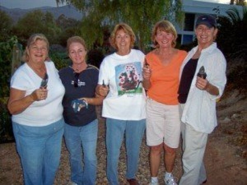 Jocelyn O'Brien, center, with friends at the last harvest of the vineyard.