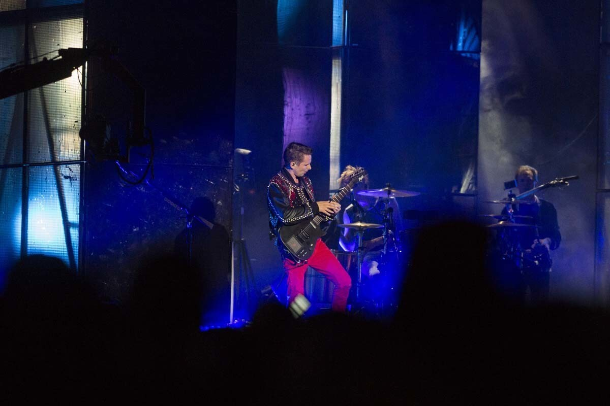 Muse lead singer Matt Bellamy performs on the Grandview Stage on Saturday evening.