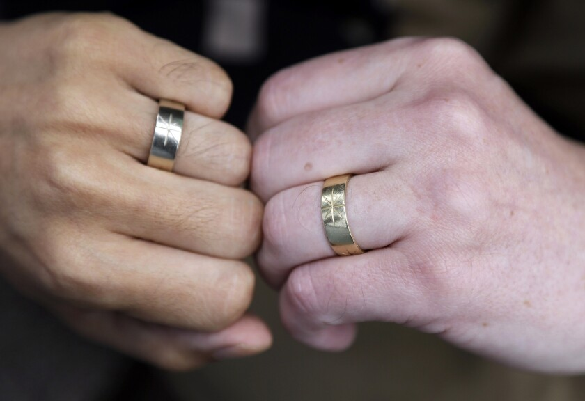 The U.S. Supreme Court is expected to rule this month in a lawsuit that challenged the constitutionality of the gay marriage ban, known as Proposition 8. Above: Thom Watson, right, and Jeff Tabaco show the rings which they exchanged during their 2009 wedding ceremony at their home in Daly City.