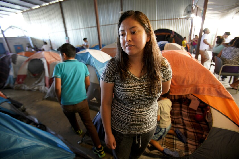 Milas Garcia along with her son, Fabian Garcia, left their home in Guatemala after her husband threa