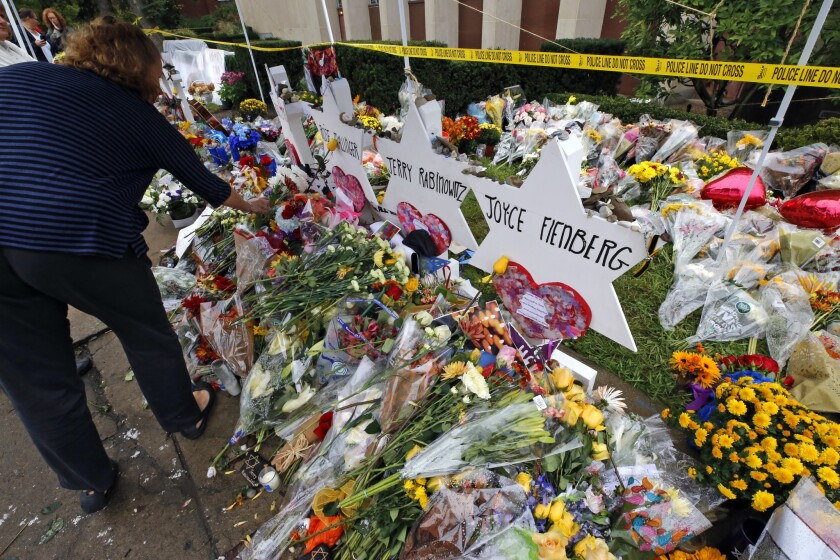 Flowers are placed Nov. 1, 2018, at a memorial outside the Tree of Life Synagogue in Pittsburgh.