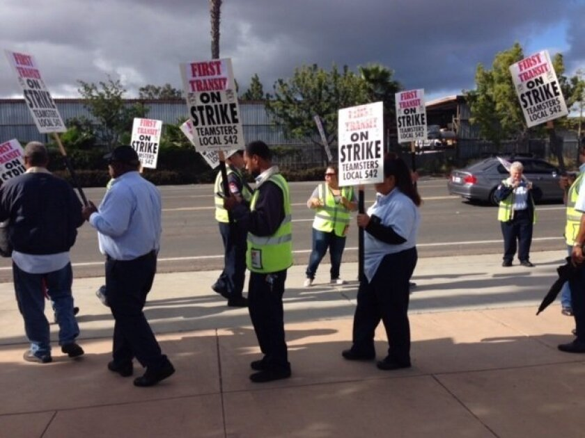 First Transit bus drivers strike in front of company headquarters in Kearny Mesa Wednesday morning.